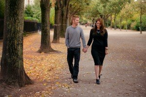 Loving couple stroll in Paris. Portrait by TripShooter Paris photographer Jade Maitre