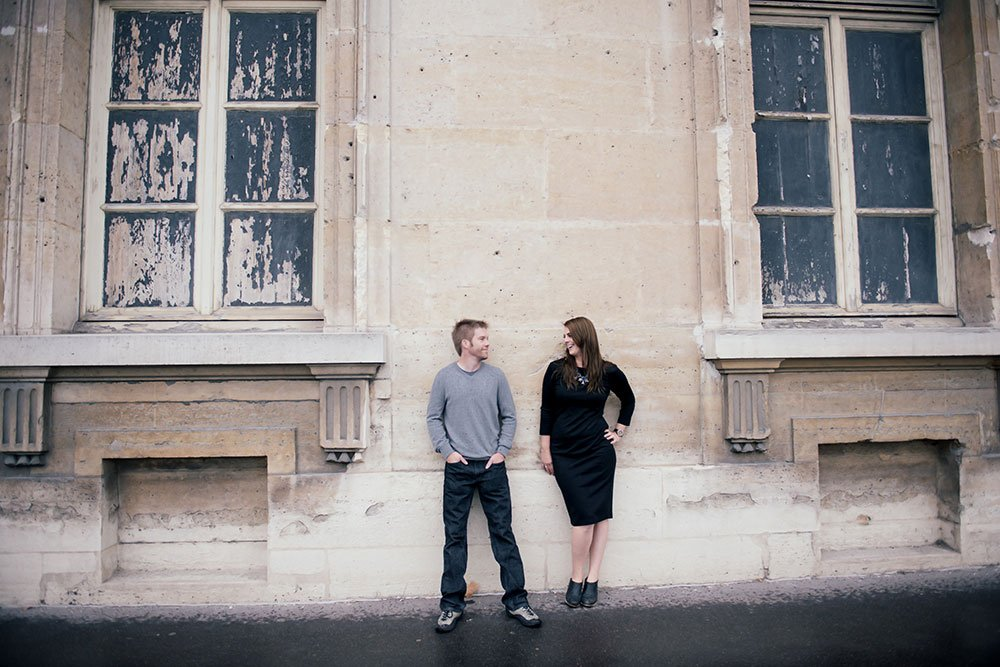 Unique couple photo at Ecole Militaire. Portrait Loving couple stroll in Paris. Portrait by TripShooter Paris photographer Jade Maitre