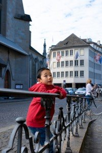 Vacation photo of travelling boy in Zurich street, photo by TripShooter photographer in Zurich Cloudia Chen