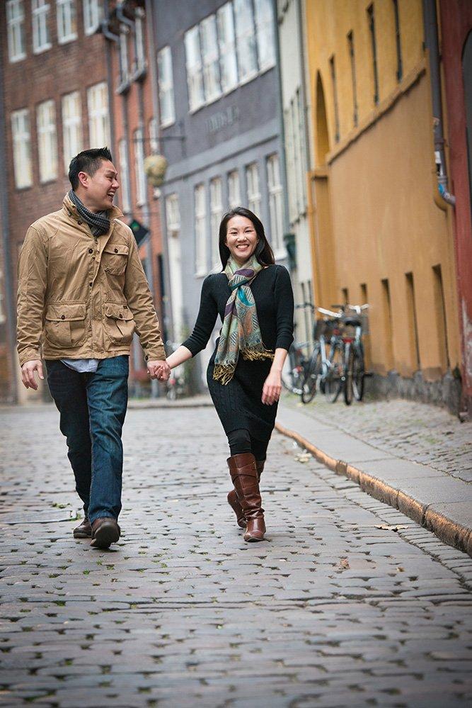 Travelling couple walking down Copenhagen street; photo by TripShooter's photographer in Copenhagen Matthew Harrison