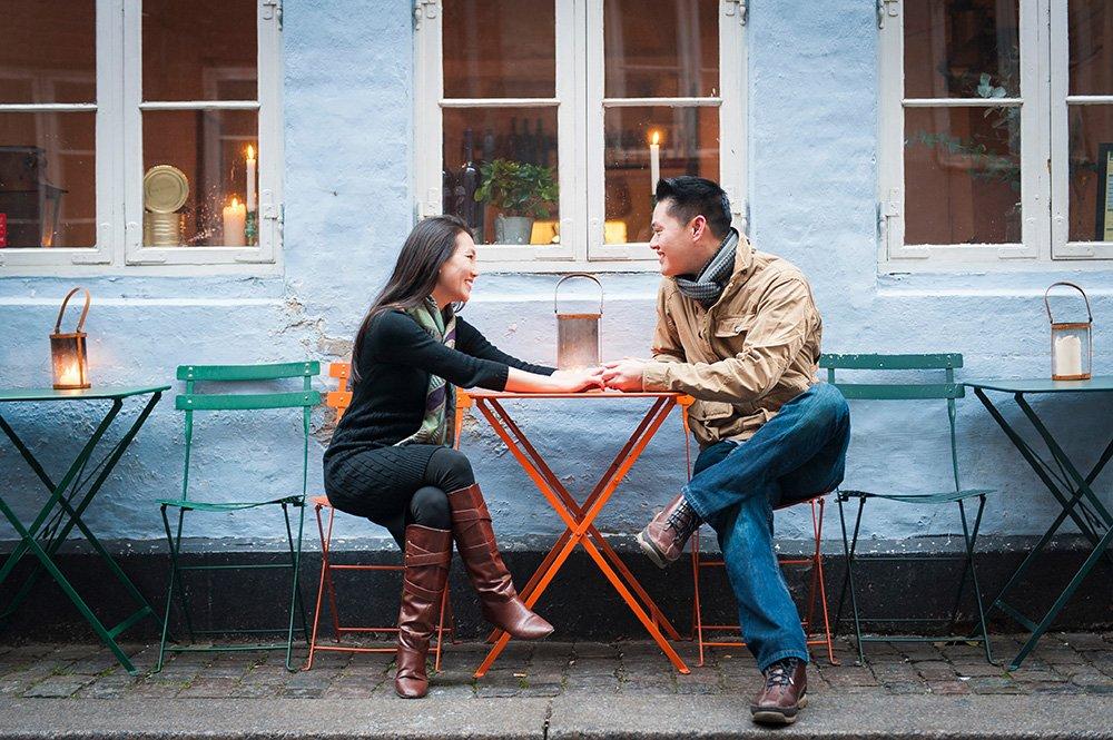 Romantic tourist couple share moment in Danish cafe; photo by TripShooter's Copenhagen photographer Matthew Harrison