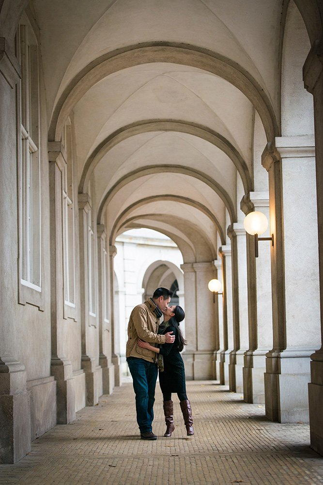 Romantic couple photo kissing under Copenhagen arches, by TripShooter's Copenhagen photographer Matthew Harrison
