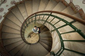 Couple photos in Copenhagen spiral staircase, photo by TripShooter's Copenhagen photographer Matthew Harrison