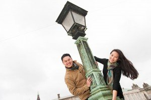 Fun couple photo around lamp post in Denmark, photo by TripShooter's Copenhagen photographer Matthew Harrison