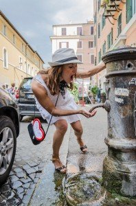 Fun vacation photos in Rome as girl plays with fountain, by TripShooter's Rome photographer Bob Fiore
