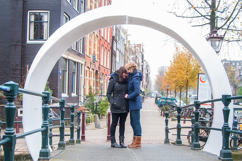 Same-sex couple embrace after surprise marriage proposal in Amsterdam, photo by TripShooter's Amsterdam photographer Cassie Jones