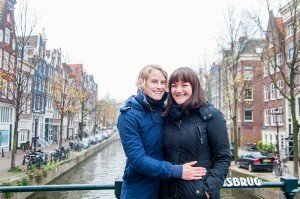 Happy lesbian couple in photoshoot at Amsterdam canal, by TripShooter's photographer in Amsterdam, Cassie Jones