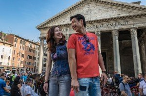 Happy coupld look over shoulders at each other in Rome, photo by TripShooter's Rome photographer Bob Fiore