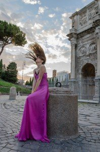 Dramatic photo shoot of woman in pink dress flicking hair, by TripShooter's Rome Photographer Bob Fiore
