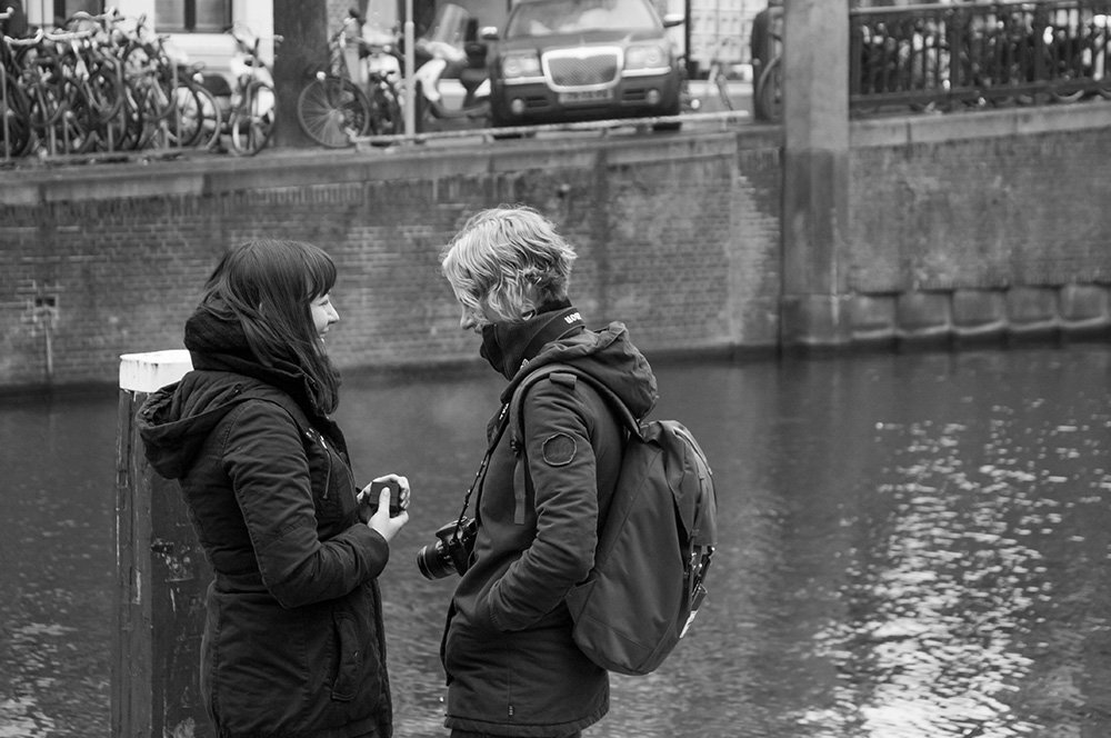 A woman proposes marriage with a ring in same-sex surprise marriage proposal photoshoot by TripShooter's Amsterdam photographer Cassie Jones
