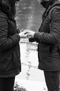 Two women exchange rings at Homomonument in Amsterdam, photo by TripShooter's photographer in Amsterdam Cassie Jones