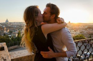 Newly engaged couple kiss in Rome sunset, by TripShooter Rome photographer Bob Fiore
