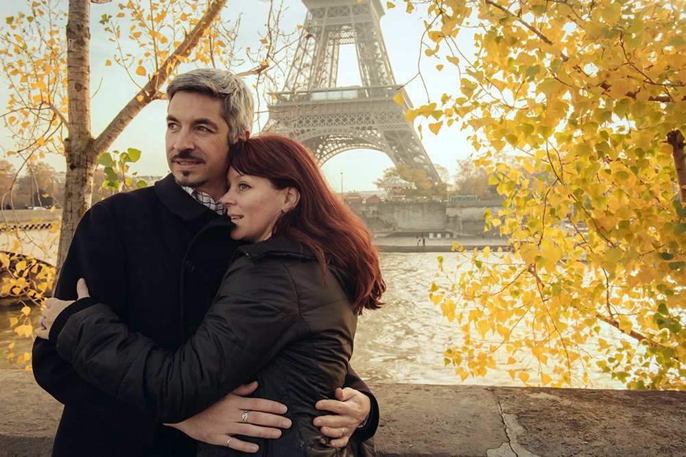 Romantic photo of married couple by the Eiffel Tower, photo by TripShooter photographer in Paris Jade Maitre