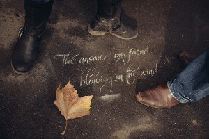 "Winter boots and autumn leaf around Paris streetart ""the answer my friend is blowing in the wind"", by TripShooter photographer in Paris Jade Maitre"