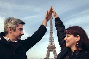 Couple hold hands above Eiffel Tower in Paris, by TripShooter's Paris photographer Jade Maitre