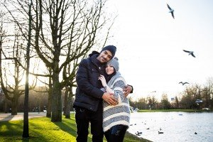 Couple embrace in winter engagement portrait session on location in Amsterdam, photo by TripShooter's Amsterdam photographer Elena Pasca