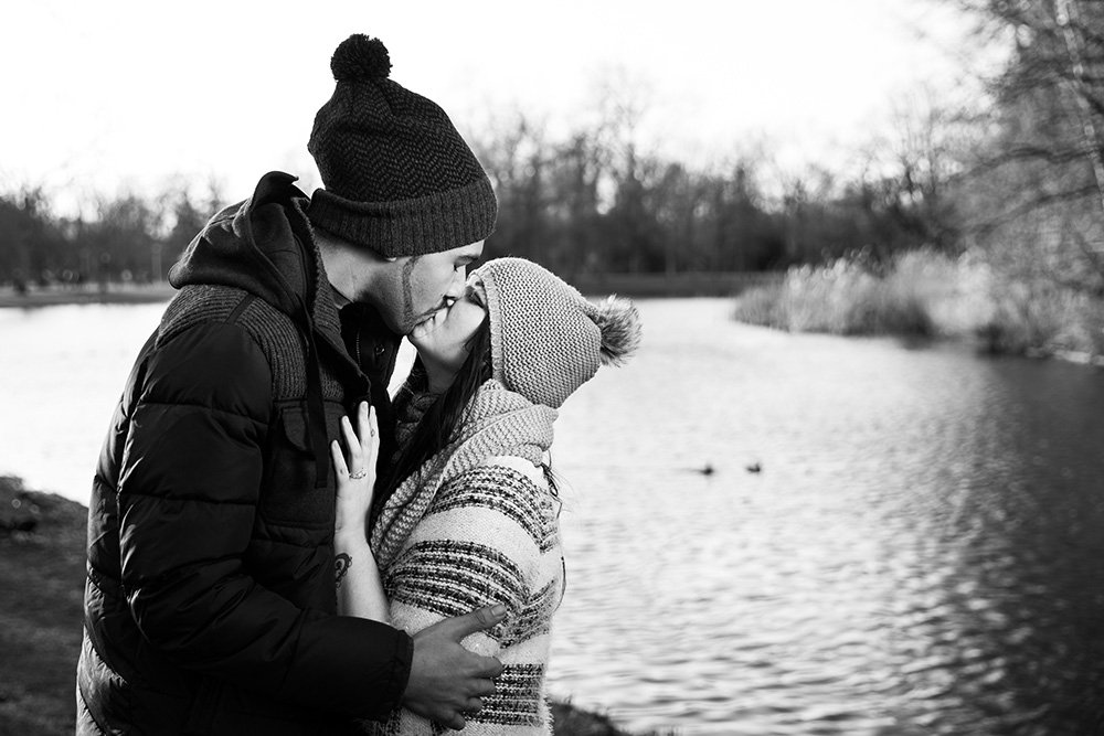 Just engaged couple kiss in Amsterdam park - photo by TripShooter's Amsterdam photographer Elena Pasca