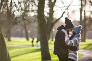 Romance in Amsterdam as couple embrace after surprise marriage proposal, photo by TripShooter's Amsterdam photographer Elena Pasca