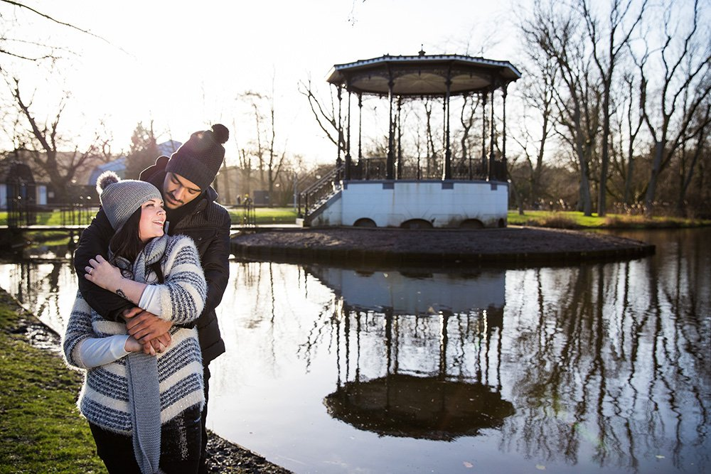 Couple look at each other with love during engagement photo session in Amsterdam, photo by TripShooter Amsterdam photographer Elena Pasca