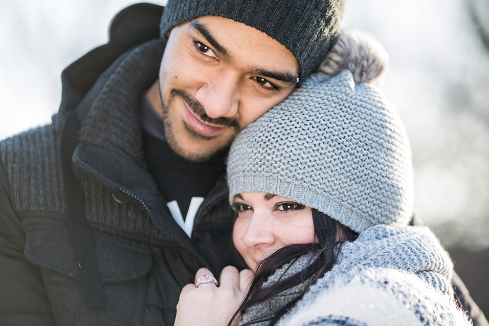 Beautiful couple portrait with winter woollen hats, photo by TripShooter photographer in Amsterdam Elena Pasca
