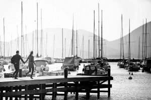 Holiday couple holding hands and walking on pier, by TripShooter's photographer in Genoa, Beatrice Moricci