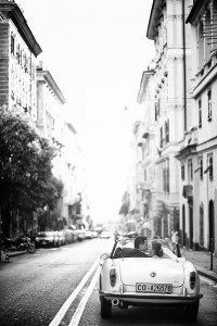 Newlyweds drive on Italian street with car, by TripShooter's photographer in Genoa, Beatrice Moricci