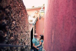 Travelling couple embrace in Italian alley, by TripShooter's photographer in Genoa, Beatrice Moricci