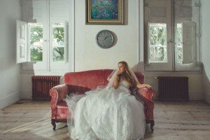 Woman in wedding dress in vintage room, by TripShooter photographers in Lisbon, Maya and Miguel Attinello