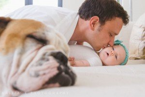 Father kisses newborn son, by TripShooter photographers in Lisbon, Maya and Miguel Attinello