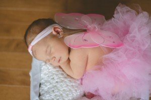 Baby sleeping in pink fairy dress, by TripShooter photographers in Lisbon, Maya and Miguel Attinello