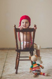 Little boy in red hat on antique chair, by TripShooter photographers in Lisbon, Maya and Miguel Attinello