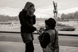 Man on one knee proposing to his beloved in Paris city of love. Photo by TripShooter's photographer in Paris, Pierre Turyan