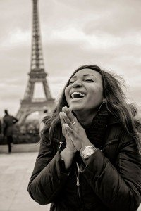 Happy fiancee laughing with ring at Eiffel Tower after surprise marriage proposal photoshoot, photo by TripShooter's Paris photographer Pierre Turyan
