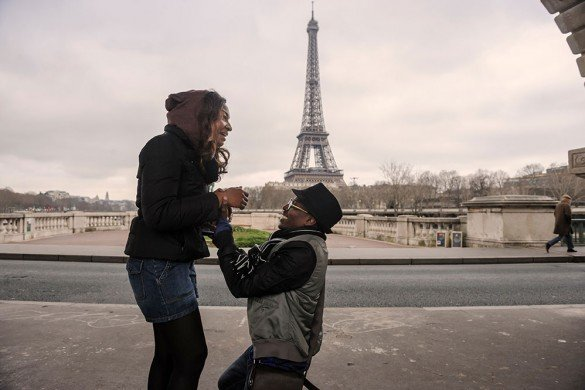 Woman laughing as man proposes marriage to her in Paris, photo by TripShooter's Paris photographer Pierre Turyan
