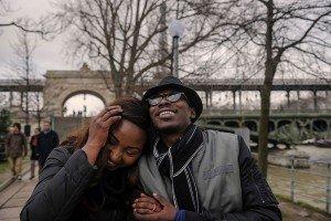 Happy couple embrace in Paris by Bir Hakeim bridge; photo by TripShooter's Paris photographer Pierre Turyan