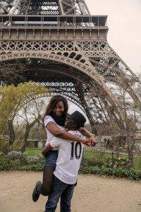 Happy couple embrace beneath the Eiffel Tower, photo byTripShooter's Paris photographer Pierre Turyan