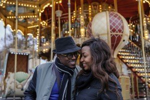 Engagement shoot of couple by Paris carousel, photo by TripShooter's photographer in Paris, Pierre Turyan