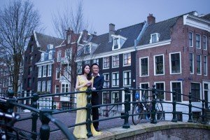 Romantic photo of couple on Amsterdam bridge, by Elena Pasca TripShooter Amsterdam photographer