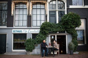 Couple enjoy Amsterdam cafe, photo by Elena Pasca TripShooter's photographer in Amsterdam