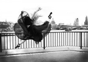 Woman in black tulle dress dancing, by TripShooter's London photographer Poppy Carter