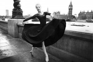 Woman in black dress dancing at Westminster, by TripShooter's London photographer Poppy Carter