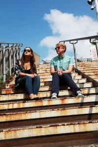 Fashion couple photo on rusty stairs, by TripShooter's London photographer Poppy Carter