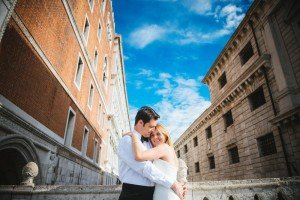 Couple embrace in Venice street, by TripShooter Venice photographer Jody Riva