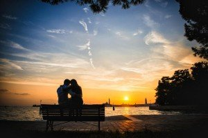Romantic silhouette of vacationing couple in Italy, by TripShooter's Venice photographer Jody Riva