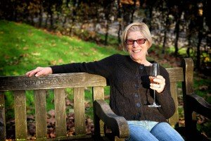 Woman on London vacation enjoying celebration champagne, photo by Shen Balendrew, TripShooter's London photographer