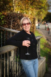 Female traveller enjoying holiday celebration with champagne, by Shen Balendrew, TripShooter's London photographer