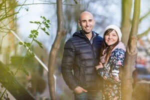 Couple smiling in trees, by TripShooter's Amsterdam photographer Elena Pasca and Radu Voineau