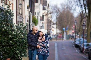 Travel couple walk on Amsterdam street, by TripShooter's Amsterdam photographer Elena Pasca and Radu Voineau
