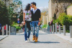 Travel couple walking on Greek street by TripShooter's Athens photographer Andreas Stavropoulos