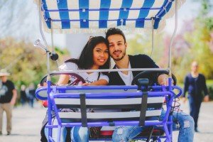 Smiling couple in blue and white tuk tuk by TripShooter's Athens photographer Andreas Stavropoulos
